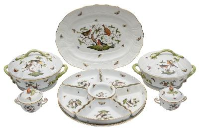 An extensive Herend porcelain part dinner service decorated in the 'Rothschild Bird' pattern of birds, scattered butterflies and foliage within spiral basket pattern moulded borders, crossed paint brushes and crowned shield marks with shape and pattern numbers, comprising: a fish dish and liner, 62 cm; an oval serving dish, 42 cm; a circular tray 37 cm; a pair of tureens and covers, 28cm wide; a two-handled sauceboat, ladle and stand; eight dinner plates 28 cm; eight soup plates 24 cm; eight dessert plates 23 cm; eight side plates 22 cm; twelve saucers in two sizes 13 and 16 cm; three two-handled cups and covers; a sugar bowl and cover [glue repair]; a milk jug; a set of five segmental dishes; a ramekin and a coffee cup [69 pieces including covers].