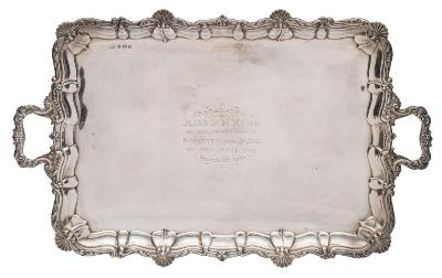 An Edward VII silver presentation tray, maker Elkington and Co, Birmingham, 1902 inscribed, of rectangular outline with foliate, scroll and shell border, with loop carrying handles to the sides, 70cm wide, 3481gms, 111.92ozs.