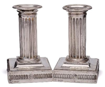 A pair of Victorian silver column candlesticks, maker Goldsmiths & Silversmiths Co, Sheffield, 1896 with beaded sconces and plain fluted columns, on square weighted bases, 13.5cm high.