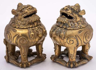 A pair of Chinese bronze incense burners in the form of Qilins each beast with hinged head and open jaws, the body cast with fire scrolls, 18th/19th Century, 16cm high.