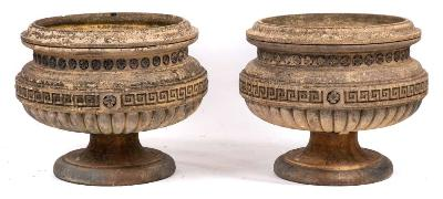 A pair of Edwardian stoneware circular pedestal garden urns, the bodies with moulded top, rosette and Greek key bands and with reeded bases, on detachable socles, 73cm (2ft 4 1/2in) diameter, 60cm (1ft 11 1/2in) high.
