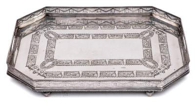 A silver plated rectangular galleried tray with canted corners, with foliate and scroll banded decoration, raised on four ball feet, 56cm.