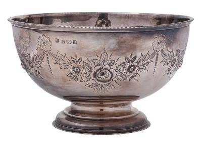 A George V silver pedestal rose bowl, maker J Sherwood & Sons, Birmingham, 1912 of circular outline with beaded border and embossed garland decoration, raised on a stepped circular foot, 19cm diameter, 376gms, 12.11ozs.