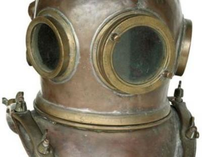 A Chilean 12 bolt copper and brass diving helmet.