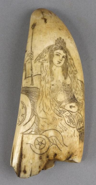A 19th century scrimshaw decorated tooth, incised with a half dressed Britannia type figure to obverse, a nude female to reverse, 14cm long.