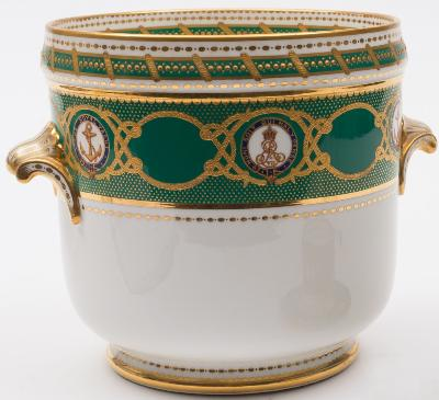 An ice pail from the Royal Service of the RY Victoria & Albert III, by Copeland, the apple green border with gilt ropework and alternating medallions for George V, gilt shell handles, the base with maker's mark and retailer's mark for T Goode & Co London, 27cm high, (hairline crack to base).