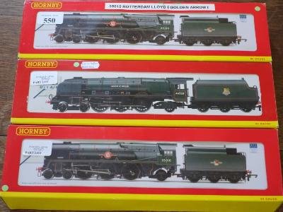 Hornby, three 4-6-2 locomotives with six wheel tenders in BR green livery No 46220 'Coronation', No 35015 ' Rotterdam LLoyd' and No 35022 'Holland America', boxed with incorrect inserts.