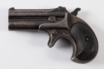 A .41 calibre Rimfire double barrelled over and under Remington Derringer pistol, number 684, stamped to underside of barrels, top flat stamped 'Remington Arms Co, Ilion, NY', all steel with black finely chequered hard rubber grips.