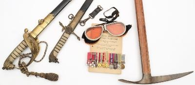 Lieutenant Col Terrence 'Sailor' Kitcat CBE, DSO, MC- a miniature group of ten medals, a George V Royal Naval dress sword and dirk, a pair of amber snow goggles and pick, also together with an copy of 'Snow and Mountain Warfare' pub War Office 1945.