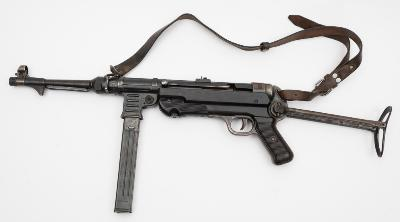 Sale SC23; Lot: 0104: A deactivated Third Reich period MP40 9mm sub machine gun by Styer-Damler-Punch AG, Steyr, Austria, number 768, 'old spec' deactivation with cocking and dry firing action, sighted barrel, Bakelite grips and folding stock, stamped 'MP40 bnz.43' to breech, also numbered '885' to other parts, Waffen marks to ammunition clip and barrel etc. original brown leather sling, COD dated 11/6/1992.