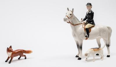 A Beswick Hunting group, comprising Huntswoman style two, standing model 1730, Girl on a Pony model 1499, one fox and eight hounds.