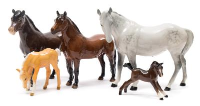 A group of Beswick Horses, comprising Grey Horse, Exmoor Pony, Dartmoor Pony and two foals.