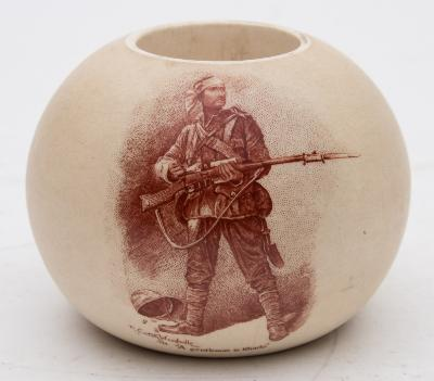 A James Macintyre pottery match holder of globular form printed in sepia with 'A gentleman in Karki' and verso with lines from 'The Absent-minded Beggar'.