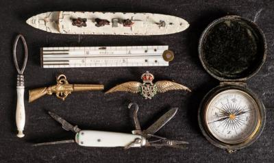 A 9ct Gold and enamel RAF sweetheart brooch together with a gilt fob watch key in the form of a musket, a pocket compass, a penknife, an ivory folding rule by J Rabone & Sons, a Dinky model of RMS Queen of Bermuda and a needle threader.