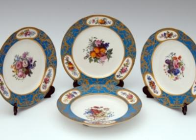 Sale SE48; Lot: 0047: Three Sèvres Plates and a Soup Plate A set of three Sèvres plates and a matching soup plate, each painted with a central spray of flowers and fruit, the rims with similar smaller floral sprays within reserves on a bleu celeste ground gilded with scrolling foliage, blue interlaced L's enclosing date code LL (1788), painters marks for Levé, Commelin and Massy, gilder's marks for Vincent, Chauveaux and possibly Vandé, 24 and 25cm diamter, the soup plate with chip to foot rim.