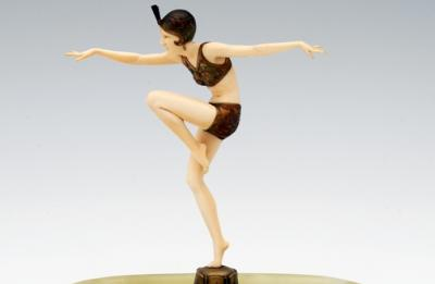 Sale SE48; Lot: 0410: Ferdinand Preiss (1882-1943) 'Con Brio' - an Art Deco cold painted bronze and ivory figure of a young lady standing on one leg with arms outstretched, mounted on a rectangular onyx dish, the bronze plinth signed 'F. PREISS', 28.5cm high overall, the dish 30cm long.
