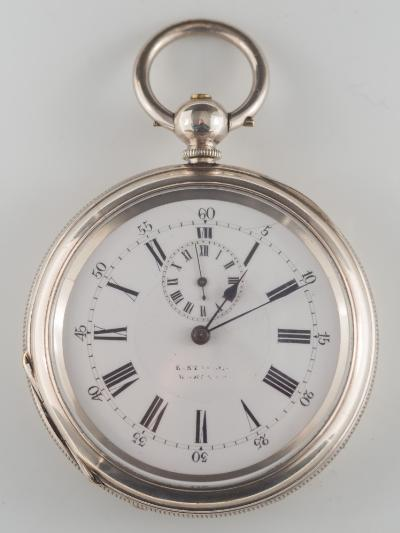 Sale SS1; Lot: 0223: A gentleman's late 19th century silver-cased open-face alarm pocket watch, the circular white enamel dial 50mm diameter with subsidiary 'alarm' dial in a 'Fine Silver' case 59mm diameter.