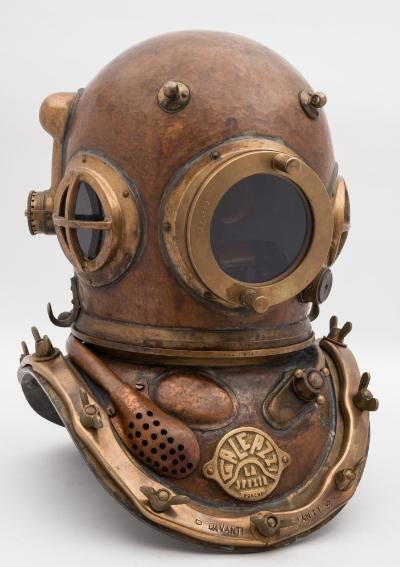 Sale SS2; Lot: 0125: An Italian 12-bolt mixed gas diving helmet by Galeazzi, number 'BPG R04' (matching), circular side and front windows, the former with guards, lashing eyes, knurled spitcock, side outlet with head button, the rear intake connecting with pie attached to the rear of the corselet for reintroducing any breathed air if required, the corselet with mouthpiece for the closed air system, regulator knob, maker's plate as per title, brass brails, 53cm high.