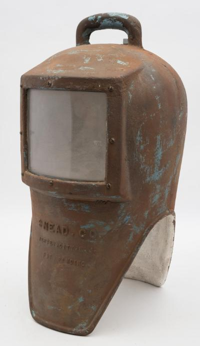An iron shallow water diving helmet by Snead & Co, New Jersey, third style, rounded handle and rear air intake, Perspex window, signed to front as per title, internal baffle plate, the interior over painted white, 55cm high.