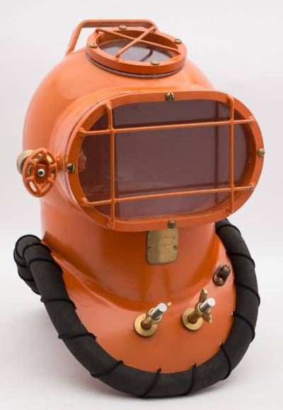 A modern steel shallow water diving helmet by Subaqueous Engineering, number 'B-05-02', top handle over circular window with guard, oval front window with guard and gas valve air inlet, maker's plaque to breastplate, safety tie off and front and rear hanging posts, 47cm high.