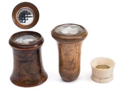 A small ivory kaleidoscope viewer together with two larger treen examples.