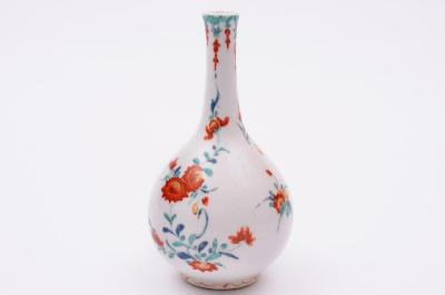 A Bow bottle vase the pear-shaped body with slender neck, painted in the Kakiemon palette with chrysanthemum and other flowers and foliage below a turquoise diaper rim hung with iron red foliage, circa 1755. (FS17/8).